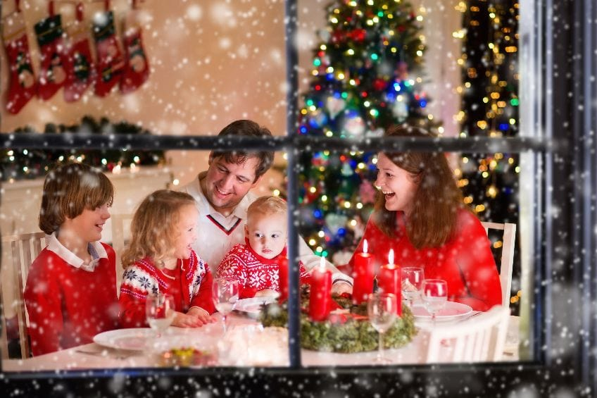 family celebrating the holidays staying warm inside with insulating window film